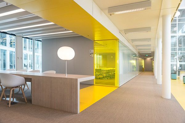 Yellow color pop corporate office space workplace for Office design yellow