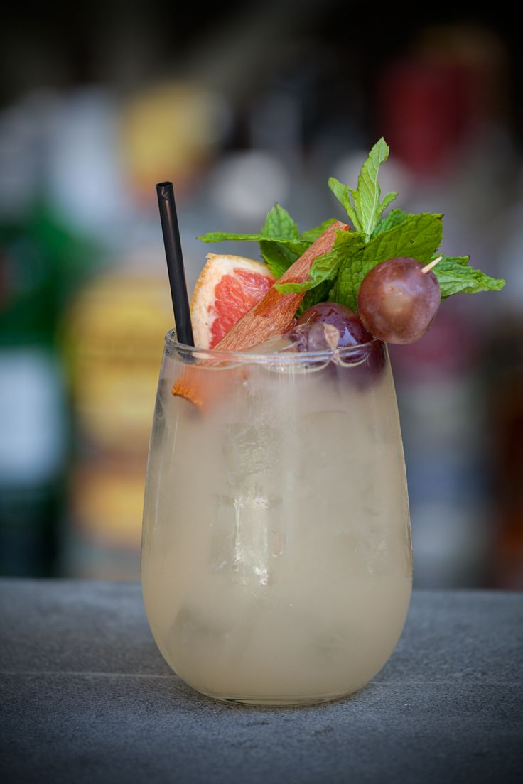 London Goes Tiki: gin, ginger, apple Sourz, grapefruit, maraschino, liquor, red grapes, lime.