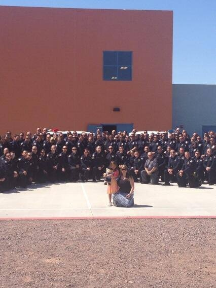 Family in Blue: Officer Daryl Raetz (Phoenix, AZ) was killed by a passing vehicle during a DUI traffic stop on March 19, 2013. On March 22, his daughter was to graduate from kindergarten. His squad decided to attend in support, but soon many more officers came. This picture is of the graduate, her mom, and extended family in blue. You don't need to be blood to be family.
