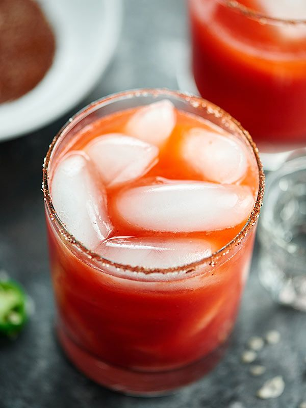 This Strawberry Jalapeno Margarita Recipe is sweet from strawberries, spicy from jalapeno, tart from lime juice, & a little smoky from the chili salt rim! showmetheyummy.com #strawberrymargarita #tequila