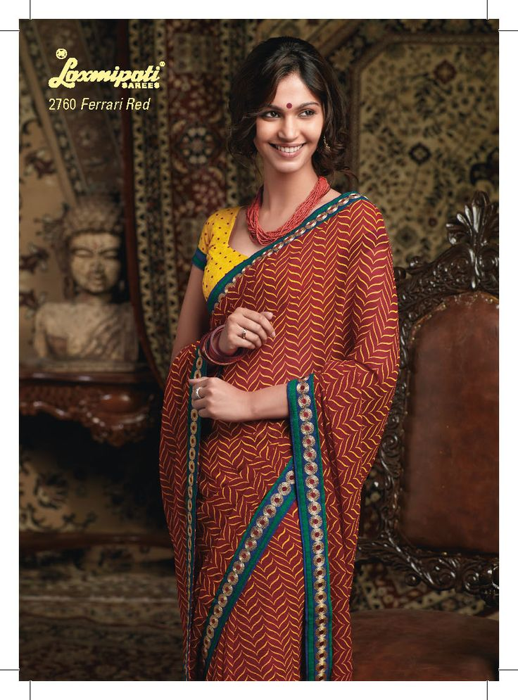 This Rust color saree with yellow color blouse piece gives stylish look