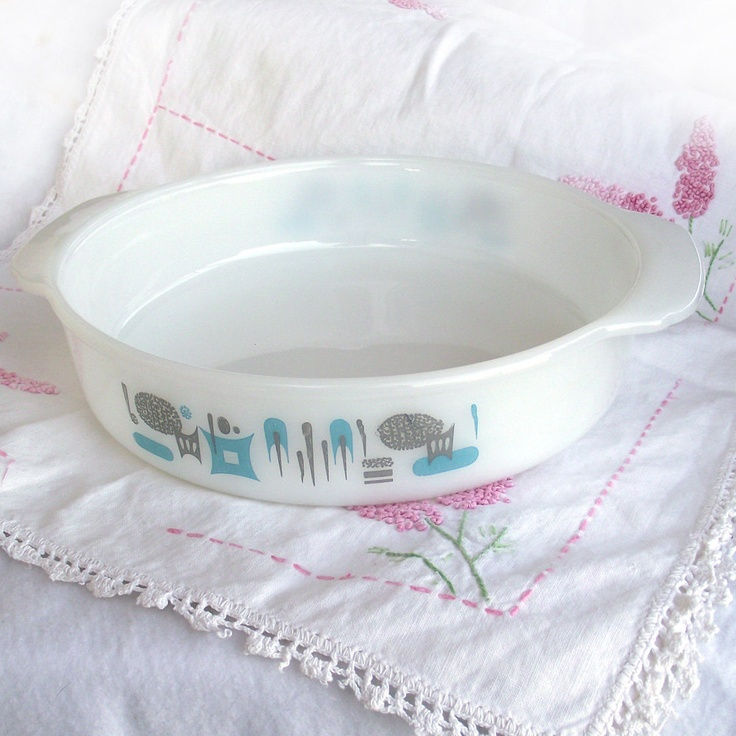 Vintage mid century Blue Heaven milk glass round baking dish, retro aqua and grey mod atomic Royal China Fire King cake pan. $12.00, via Etsy.