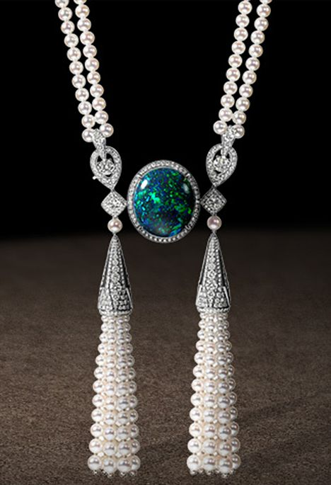 Necklace in platinum, diamonds, cultured pearls, and cabochon-cut green opal.