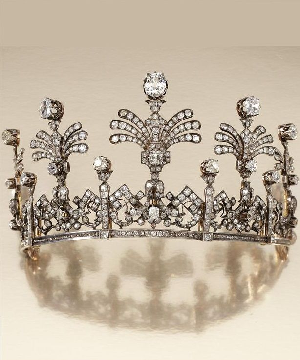 DIAMOND TIARA, MID 19TH CENTURY. Designed as a graduated series of openwork articulated panels of stylised Greek key and foliate scrolls, surmounted by five graduated stylised fan palm sprays, set with cushion-shaped, circular- and rose-cut diamonds. #Antique #Tiara