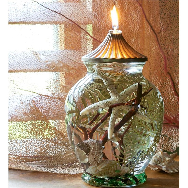 Seashell Oil Candle made with smokeless, odorless liquid paraffin with fiberglass wick that lasts a lifetime.  Wish I could make my own.