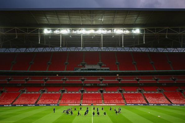 The San Marino squad warm up on the pitch during the San Marino training session at Wembley Stadium on October 8, 2014 in London, England. San Marino will play England on 9th October in a Euro 2016 Group E Qualifier.