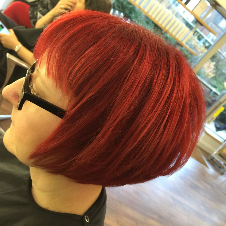 Gorgeous red hair, pre pigged first with temporary colour before the perm & semi in the ends were applied. Paul Mitchell colours used.