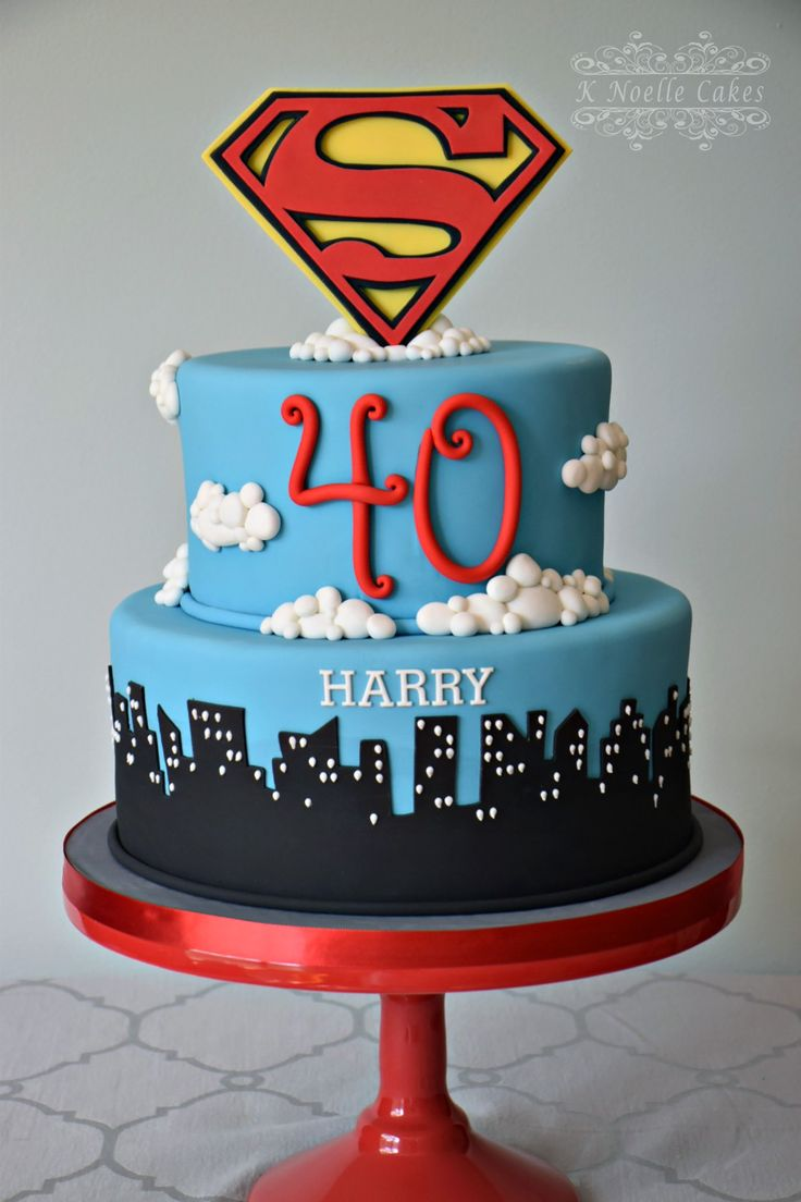Superman birthday cake with skyline by K Noelle Cakes