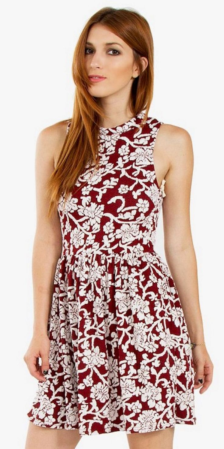 Enchanting Garden Dress Floral knit skater dress with a mock neck. Stretch fabric. Exposed zipper closure on back. Burgundy color currently not available.