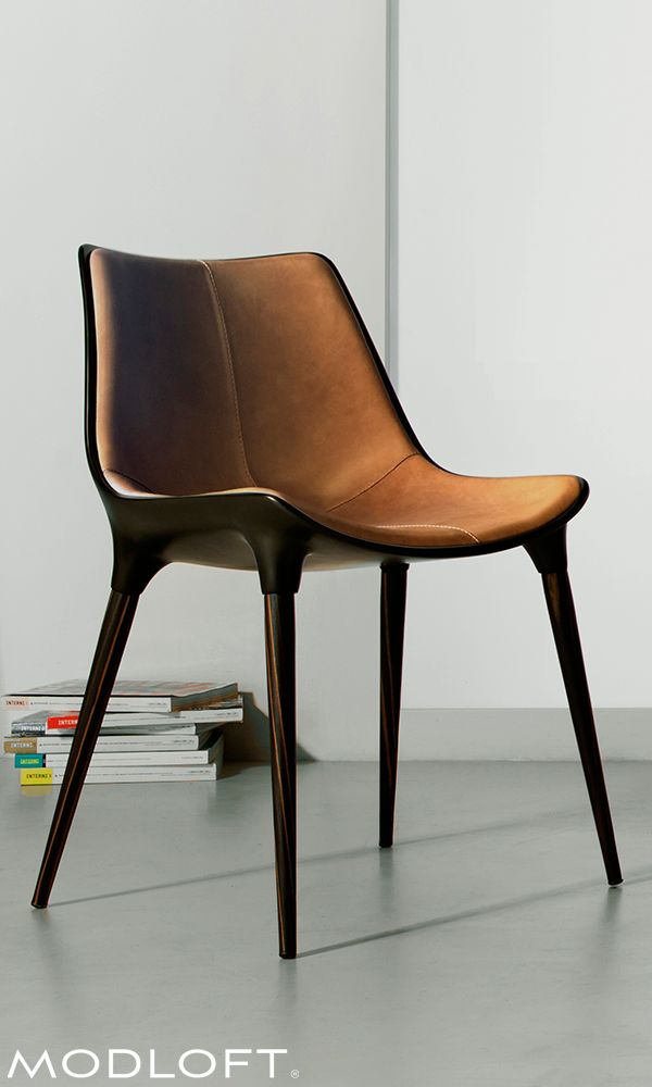 The beautiful Langham dining chair by Modloft is made with steel core legs finished in Brazilian ebony veneer, a bucket seat made of fiberglass finished in black matte, and upholstered in distressed caramel genuine leather making it (in our opinion) our favorite chair. Available in our quick-ship program for immediate delivery.