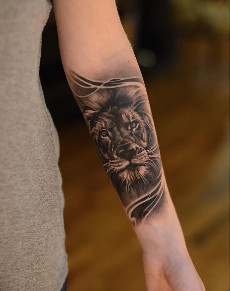 Lion on forearm -Lion tattoo by @Charles Saucier at Imperial Tattoo in Toronto, Ontario, CA