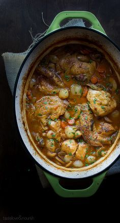Coq au Vin Blanc- A twist on a Traditional Braised Chicken Dish made with red wine, but made with white wine instead, which is less overpowering and doesn't affect the color of the chicken. An amazing recipe that serves 8!