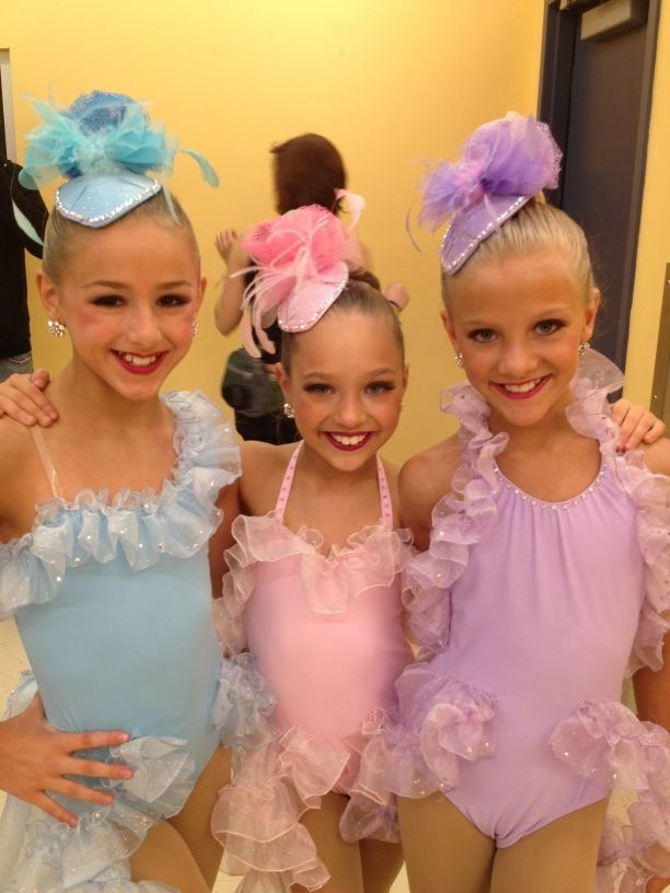 "Chloe Lukasiak(blue), Maddie Ziegler(pink), and Paige Hyland(purple) in their costumes for ""La Divas"""