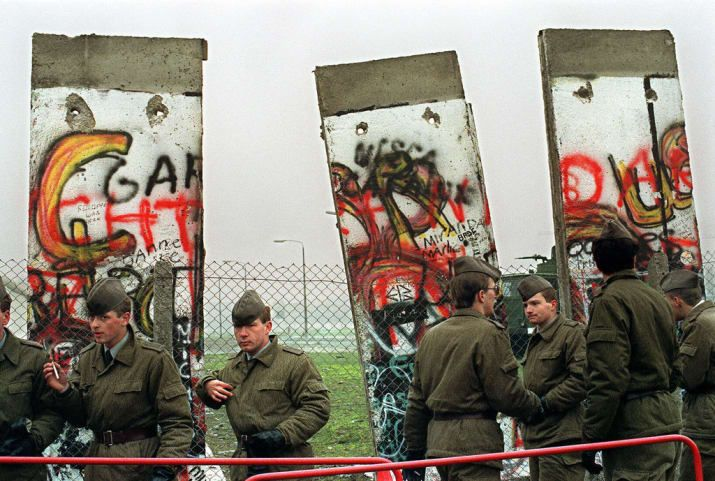 Within days, the East German government had joined in. Here East German soldiers open a new crossing point.