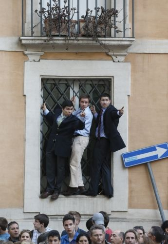 BOYS STAND ON A WINDOW LEDGE OUTSIDE ROME'S CHURCH OF ST. IGNATIUS, WHERE POPE FRANCIS CELEBRATED MASS APRIL 24. THE MASS WAS IN THANKSGIVING FOR THE CANONIZATION OF BRAZILIAN ST. JOSE DE ANCHIETA. (CNS PHOTO/PAUL HARING)
