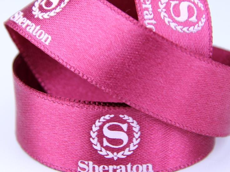 Giftribbon with silkscreen printing with releif effect  http://www.minanamnband.se/presentband-shop/satin-presentband-med-egen-logga-och-design