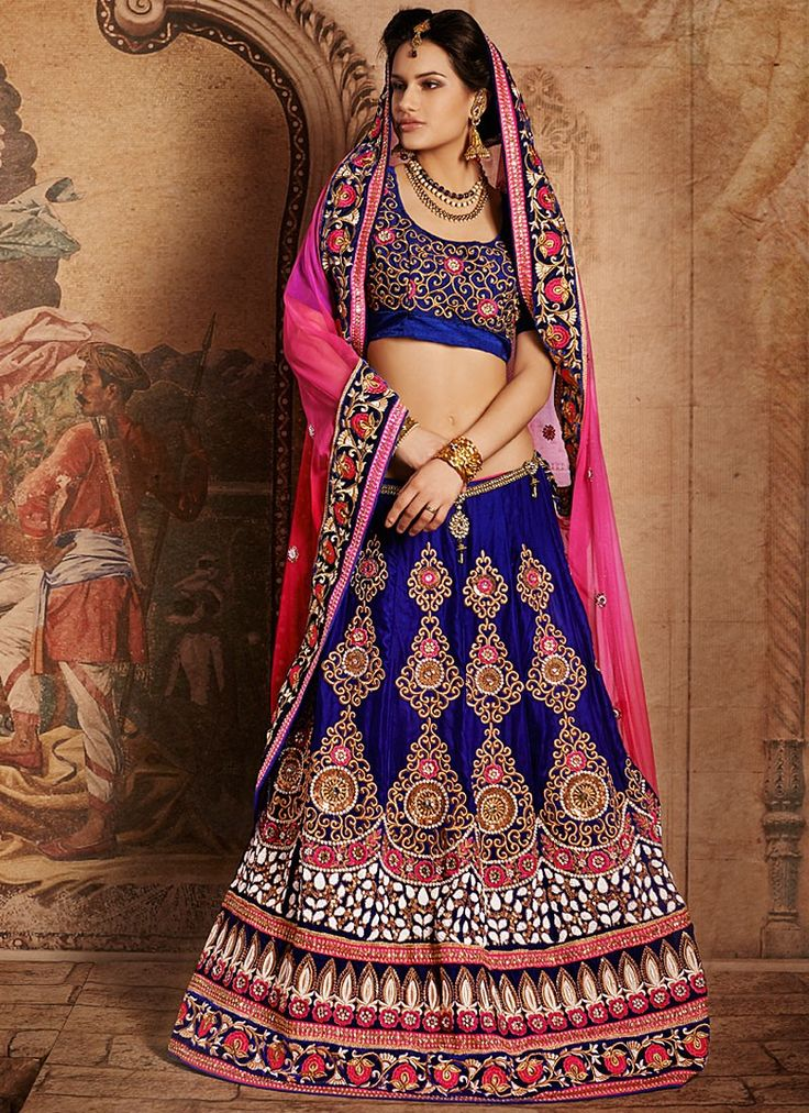 Shop this product from here.. http://www.silkmuseumsurat.in/blue-stone-enhanced-velvet-lehenga-choli?filter_name=4632  Item :#4632  Color : Blue Fabric : Velvet Occasion : Bridal, Party, Reception, Wedding Style : A Line Lehenga Work : Applique, Embroidered, Patch Border, Resham