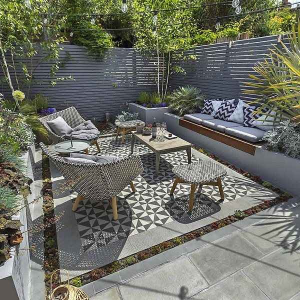 Private Small Garden Design . Like the seating and string of lights across. Multi stem silver birch trees