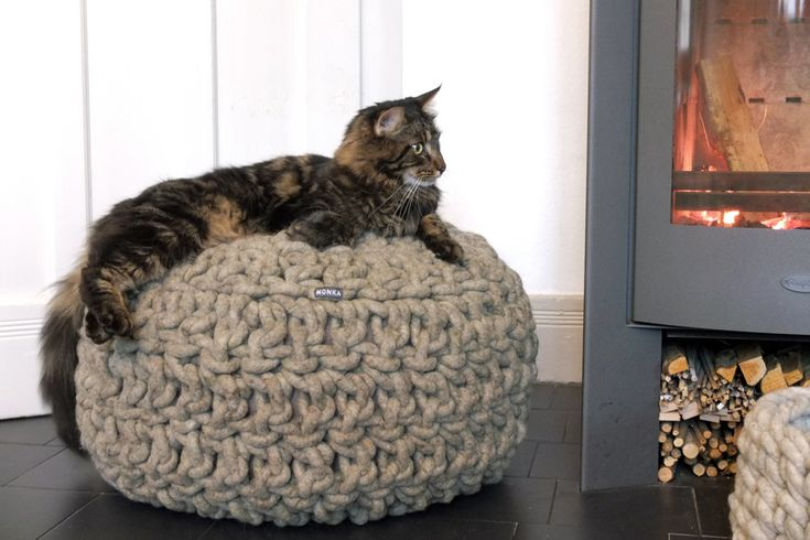Hand-crocheted #pouf in 10 colours of #felted #purewool and filled with #natural #fibers.