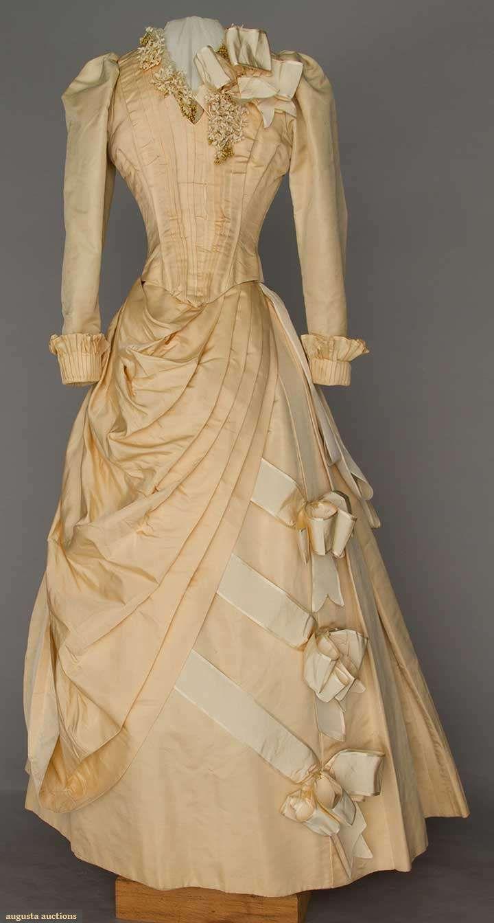 CREAM SILK WEDDING GOWN, c. 1892 2-piece, long pleated faille bodice w/ cloth flower & wax blossom trim, pleated drape bustle skirt, silk moire bows