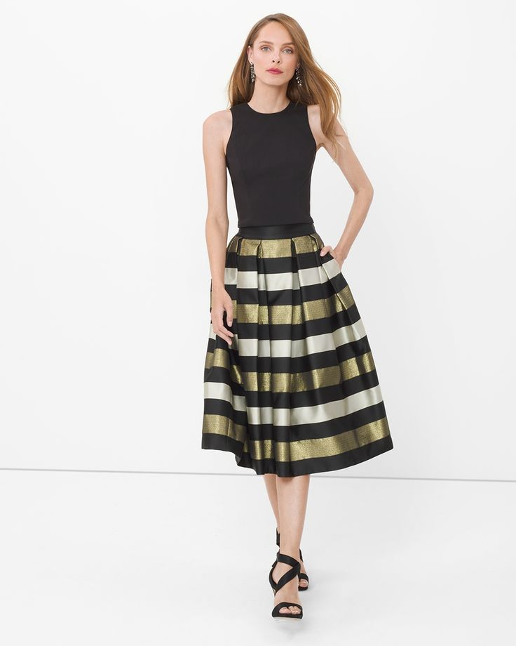 "Meet the taffeta midi skirt you'll want to wear with everything in your closet. Sits on the waist with crisp inverted pleats falling into a full, flared silhouette. We love how it looks with flirty little flats or strappy high heels.   Stripe taffeta midi skirt  Black with gold and white stripes On-seam pockets Back zip Lined Sits 1/2"" below natural waist and hits mid calf Regular: approx. 30"" center back length Petite: approx. 28 5/8"" center back length Polyester/metallic. Machine wash…"