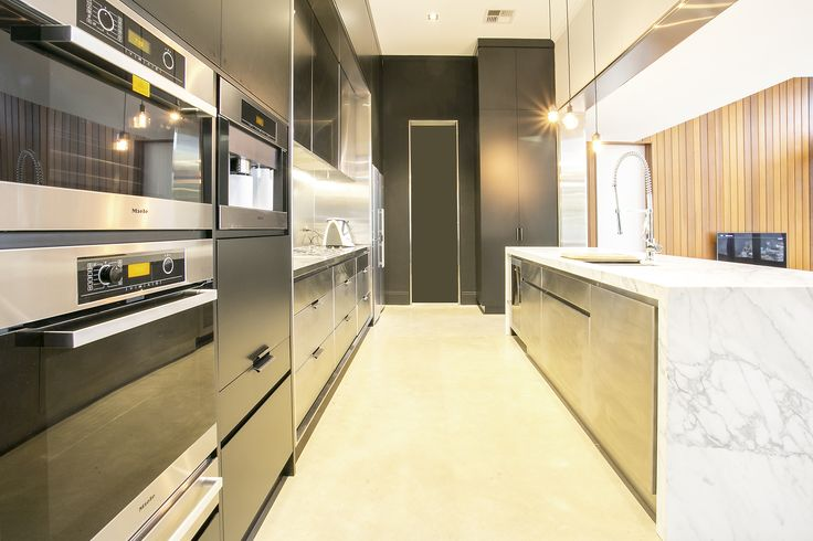 Kitchen of our St Peters renovation & extension.  Feat. Statuario Calcutta marble, stainless steel & 2pac cabinetay & polished concrete flooring