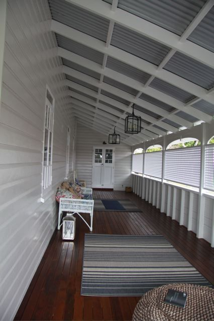 Queenslander - decking and white paint outside