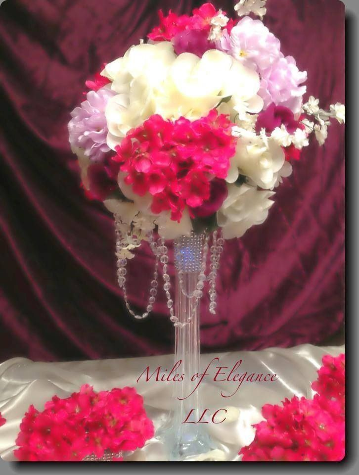 Fuchsia and lavender hydrangea with ivory rose centerpiece