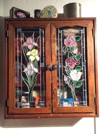 Tea Garden Cabinet - The cabinet was built for me by my grandfather when I was in high school. When I began doing stained glass, nearly thirty years later, these were my first two panels to try. I wanted to replace the window glass in the cabinet doors with some I made to make it a joint project, even though my grandfather was no longer alive. The rose was first, perhaps my fifth or sixth project, the only previous projects were sun catchers for practice.