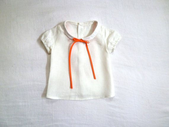 Linen blouse with peter pan collar and orange tie.