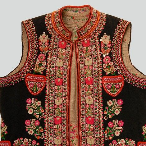Poland - Man's vest of black wool. Embroidery and sequins. Trimmed with red wool