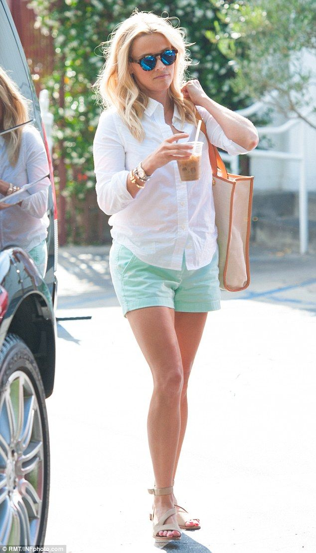 Made for summer... Witherspoon wore a white shirt with mint green shorts and nude sandals