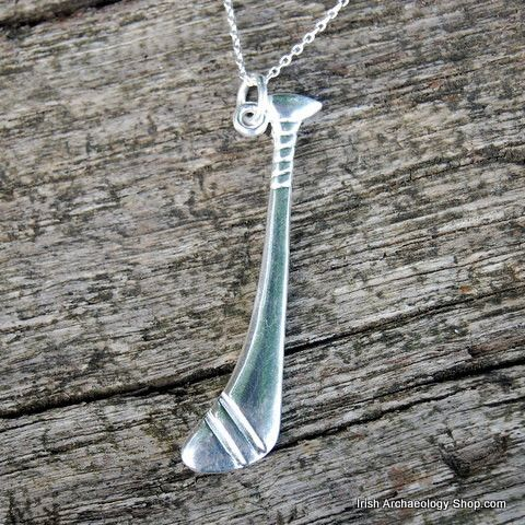 This silver pendant is based on the Irish hurley. Ireland's national game, hurling is arguably the fastest field sport in the world and quite possibly the oldest. It is played with sticks called hurleys, a ball known as a sliotar, and by two teams of 15 who play on a large pitch with goals at either end. The most famous early account of hurling is found in the Tain Bo Cuailgne, which describes the exploits of the Ulster hero Cú Chullainn. Hurling is mentioned a number of times in the text, …