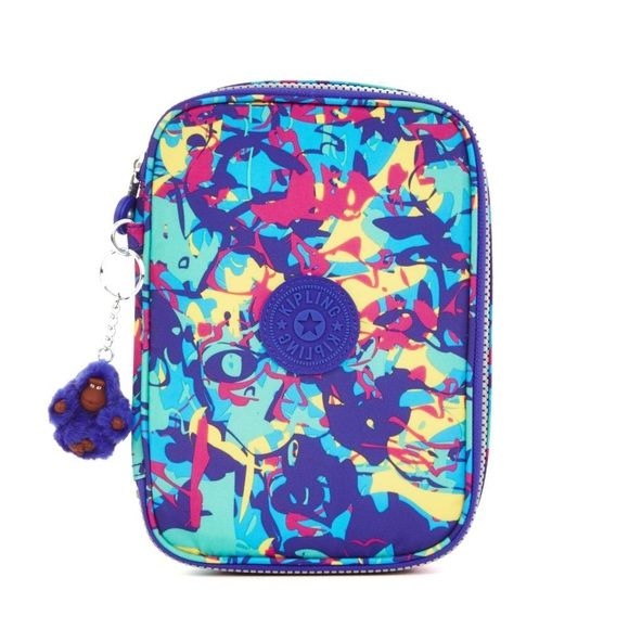 Kipling 100 Pens Printed Case. 100 Pens Printed Case. Brand new with tags. Full zip around closure. Center divider holds 12 pens sleeves and inside top panel hold 14 pen sleeves. Interior large enough to hold all your small essentials. Small furry Kipling monkey key ring. Kipling Bags