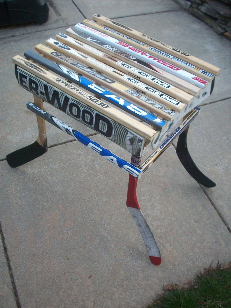 Hockey stick side table. All it needs is some puck coasters!