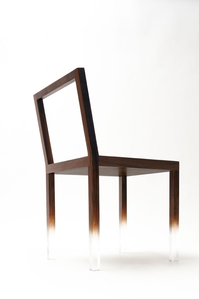 """""""floating"""" chair effect. it's clear acrylic, with wood-grain painted on."""
