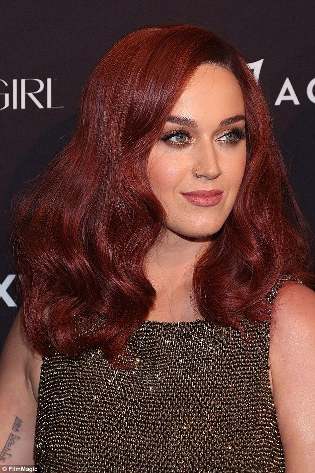 New look: The Hot N Cold singer added a deep pink lip colour and shimmering eye makeup to ...
