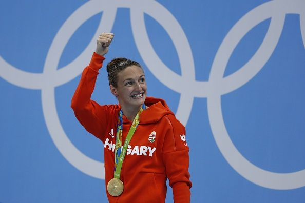 Hungary's Katinka Hosszu celebrates on the podium with her gold medal after she won the Women's 400m Individual Medley Final during the swimming...