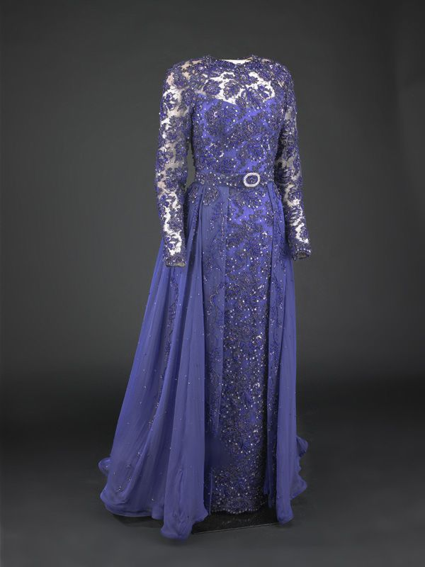 Hillary Clinton wore this violet beaded lace sheath gown with iridescent blue velvet silk mousseline overskirt to the 1993 inaugural balls. The dress was designed by Sarah Phillips and made by Barbara Matera Ltd., a New York theatrical costume maker.