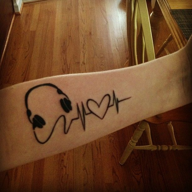 I always say my heart beats to the music that's playing. So I absolutely love this tattoo. Not the placement though