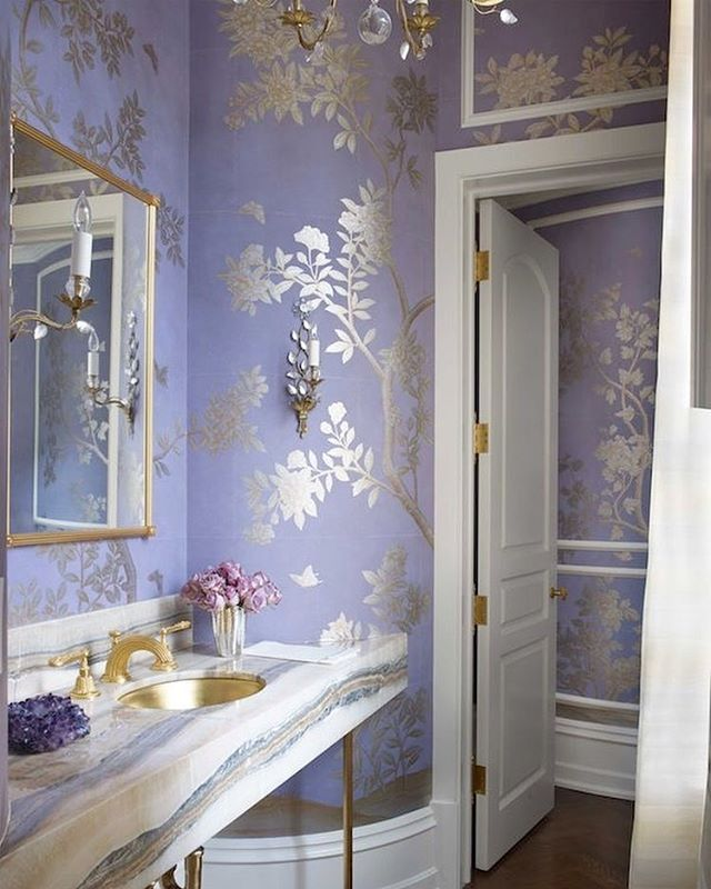 My love for lavender grows with this #exquisite powder room by @suzannekasler.  Featuring gold fixtures, a sparkling crystal #chandelier, and #handpaintedwallpaper from @graciestudio, this is timeless elegance at its finest. ✨✨✨✨  @verandamagazine