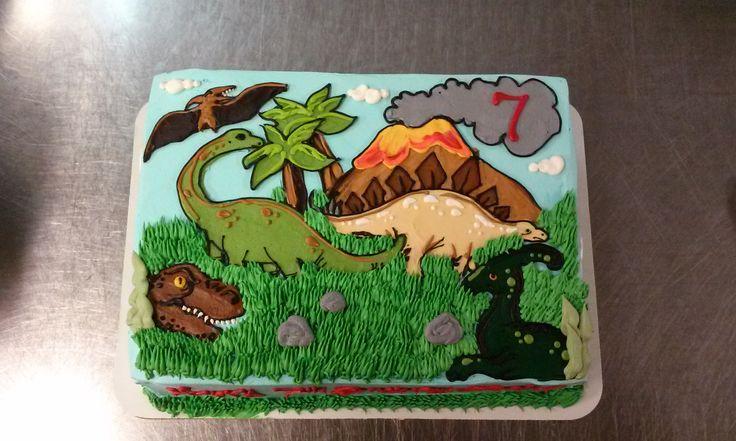A Quarter Sheet Cake With A Whimsical Dinosaur