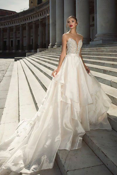 The Italian tour de force continued at Julie Vino, where the designer used the historic city of Naples as her jumping-off point. You'll feel as if you're floating down the aisle in this breathtaking two-piece look.