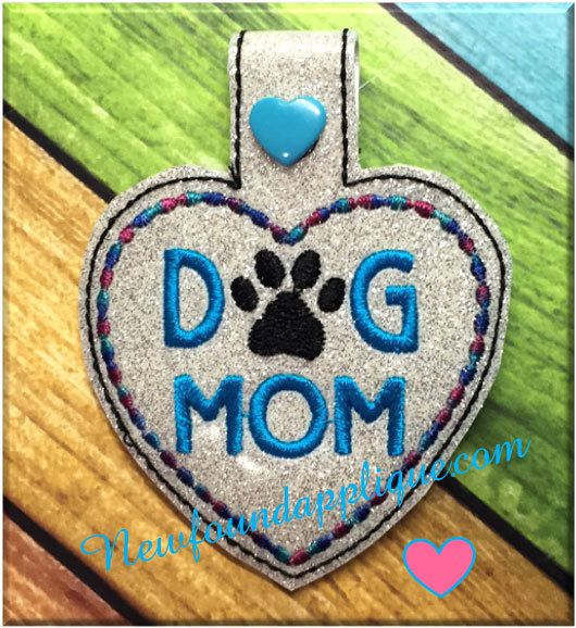 Newfound Applique  - In The Hoop Dog Mom Snap Tab Key Fob Embroidery Machine Design, $2.99 (http://www.newfoundapplique.com/in-the-hoop-dog-mom-snap-tab-key-fob-embroidery-machine-design/)