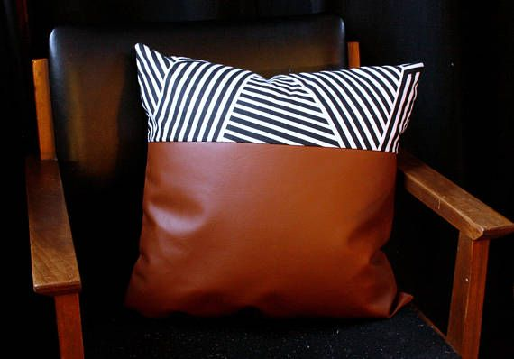//product details// Faux leather pillow cover, with a panel of modern printed material. The back of the pillow is finished in a black backing, and the metal zipper closure is hidden. The pillow cover is 18x18. We recommending sizing up the pillow insert 1 or 2 sizes to really fill