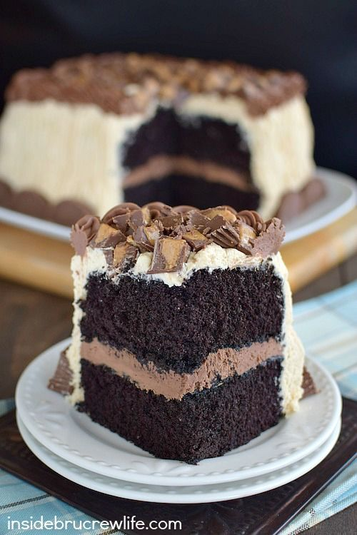 This homemade chocolate cake covered in peanut butter frosting and peanut butter cups is seriously the best I have ever had!