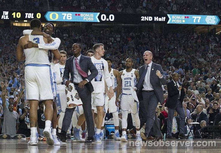 North Carolina's Kennedy Meeks (3) is embraced by teammate Brandon Robinson (14) after Meeks secured an offensive rebound with four second to play to secure North Carolina's 77-76 victory over Oregon in the NCAA National semifinal game on Saturday, April 1, 2017 at the University of Phoenix Stadium in Glendale, Arizona.