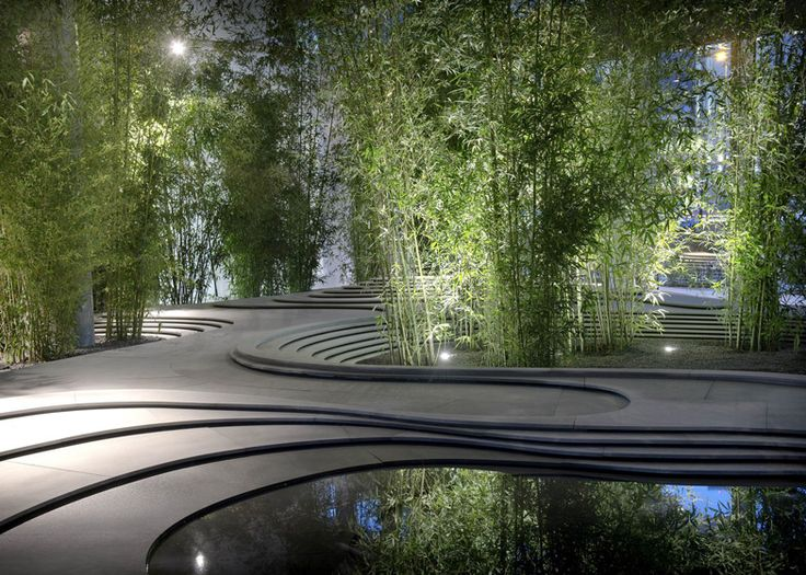 milan 2013 bamboo trees sprouted up around a topographical landscape of stone and water at