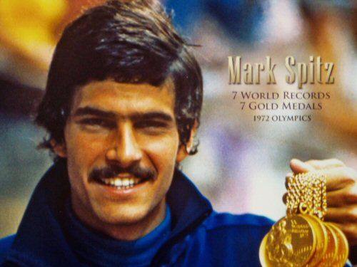 At the 1972 Summer Olympics, swimmer Mark Spitz captured his seventh Olympic…