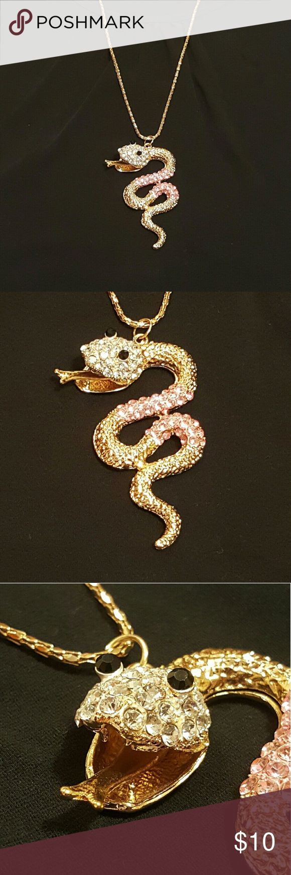NWOT snake fashion necklace *STATEMENT PIECE* Eye catching sparkling snake necklace, NWOT Chain is 29 inches long Snake is approx 4 inches in height x 1.5 inches wide Jewelry Necklaces
